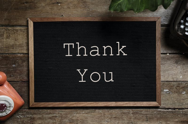 3 thank you text on black and brown board