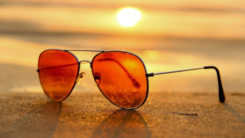 Sunglasses on Beach at Sunset